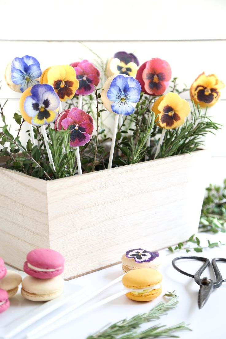 Realistic edible-paper pansies and pretty pastel macarons take this giftable edible bouquet to new heights.