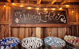 Turn an old horse trough into a watering hold for two-legged guests for a wedding reception in a barn. MargotMadison
