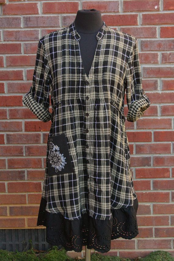 This soft and very comfortable tunic features plaid on the outside and tan/black gingham check on the inside, a tie back, pin tucking and a pocket