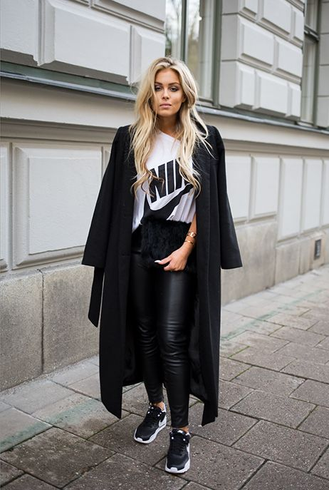 If you are in love with sports, then go for this trendy look that consists of ankle,length black belted coat, big white T,shirt, black leather leggings,