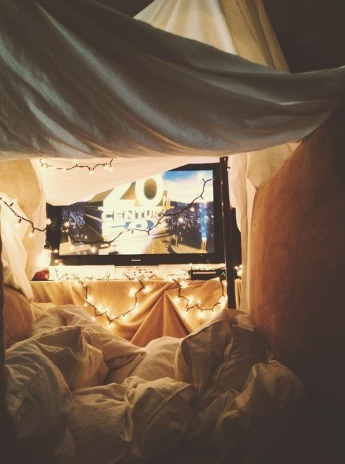 Build a blanket fort that can stand the weight of us, food and a mini cinema screen #blanketfort #bedfort #chilled