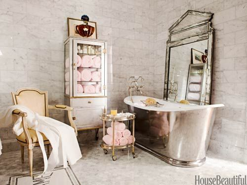 Parisian Bathroom - note floor-mounted water filler, the 19th century crystal chandelier, freestanding nickel-leg washstands, vintage glass pharmacy chest.  There is a period feel; yet functional.