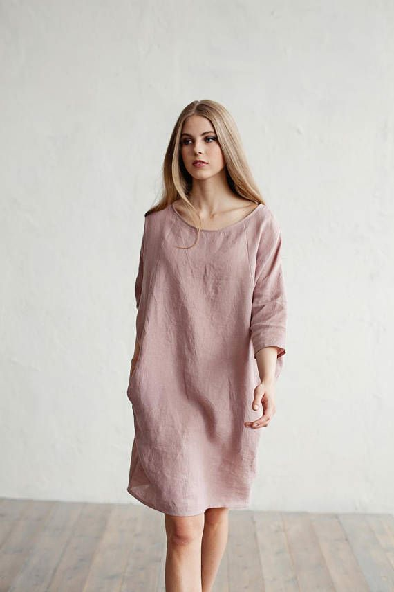 Loose fitted linen dress. Soft and washed linen dress with 3/4 sleeves and 2 pockets. This pure linen dress will keep you covered up from the sun while still staying cool, thanks to linen's great breathable quality. Can be made in more than 15 colours- blue, grey, red, pink, yellow, white and other.