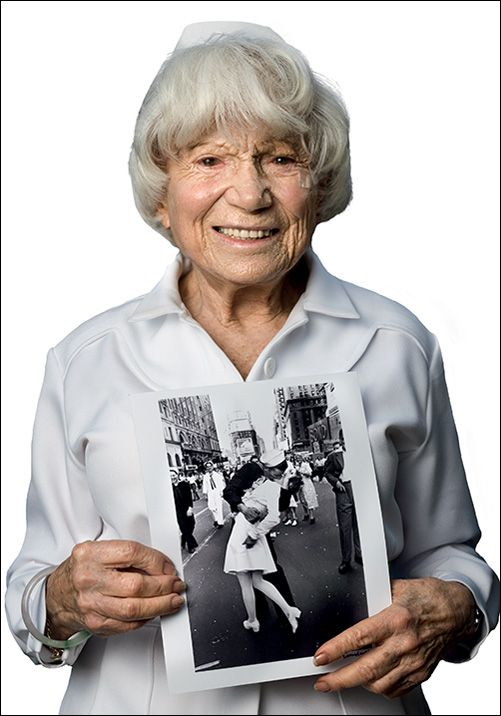 Edith Shain, holding the iconic photograph taken by Alfred Eisenstaedt. Originally published in LIFE Magazine, the photo depicts a sailor kissing Edith Shain in her nurse's uniform, in Times Square on August 14, 1945