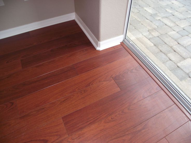 Finished laminate flooring at sliding glass door