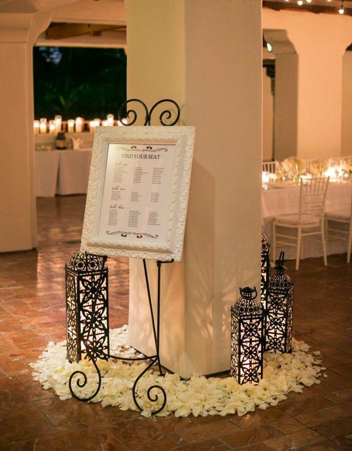 To see more gorgeous wedding flower ideas: http://www.pinterest.com/modwedding/wedding-centerpiece-ideas/  #wedding #weddings #seating_chart  photo: Ryan Phillips