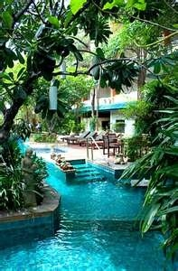 Gosh, I'd love to have a pool like this...Easy steps down in and gradually getting deeper....Fantastic!