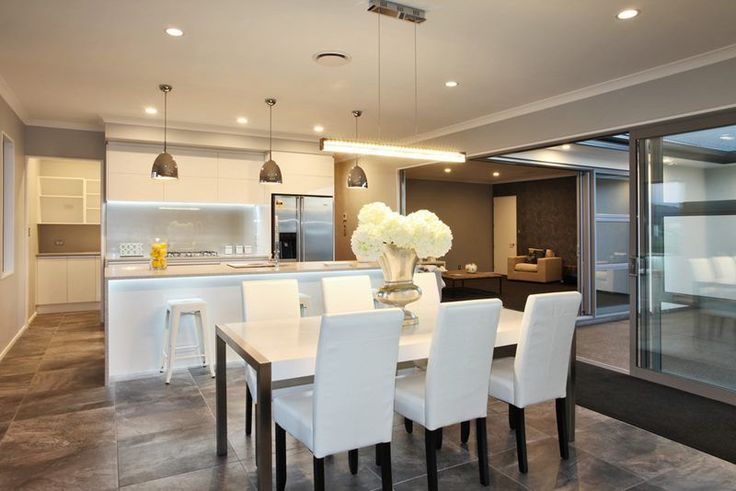 White kitchen and dining room suite. Wooden planking