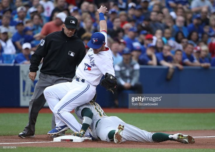 Rajai Davis #56 of the Oakland Athletics is caught stealing third base in the first inning during MLB game action as Josh Donaldson #20 of the Toronto Blue Jays tags him out at Rogers Centre on July 24, 2017 in Toronto, Canada.
