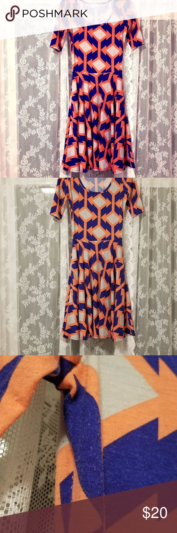 Lularoe Blue Coral and Grey Nicole XS This listing is for a Lularoe blue, coral, and grey Nicole dress, size extra small. The colorful pattern is more coral than orange in person. It is made in the USA and in GUC. Please review light pilling in photos. It is mainly under the arm and not noticeable during wear. LuLaRoe Dresses Long Sleeve