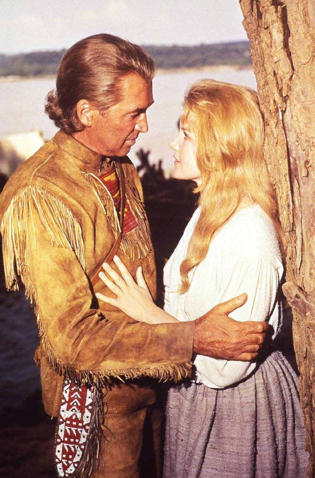 James Stewart and Carroll Baker in How the West Was Won. The all-star cast also includes (in alphabetical order)     Walter Brennan, Lee J. Cobb, Andy Devine, Henry Fonda, Carolyn Jones, Karl Malden, Harry Morgan, Gregory Peck, George Peppard, Robert Preston, Debbie Reynolds,  , Eli Wallach, John Wayne, and Richard Widmark. The film is narrated by Spencer Tracy.