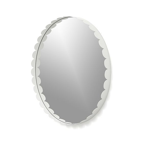 I am not sure about a round mirror for the bathroom but isn't this just the cutest mirror you ever did see?