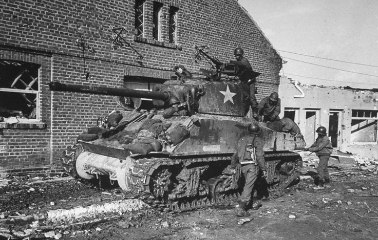 "An African-American tank crew prepares a Sherman M4 for battle ""somewhere in Germany,"" spring 1945.   Read more: 'Fury' in the Real World: Photos of Tank Warfare in World War II 
