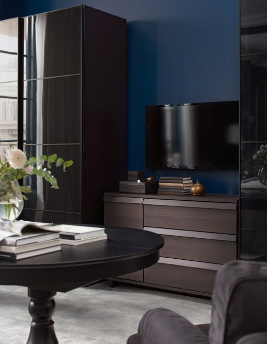 Bedroom wardrobes with sliding doors and a chest of drawers