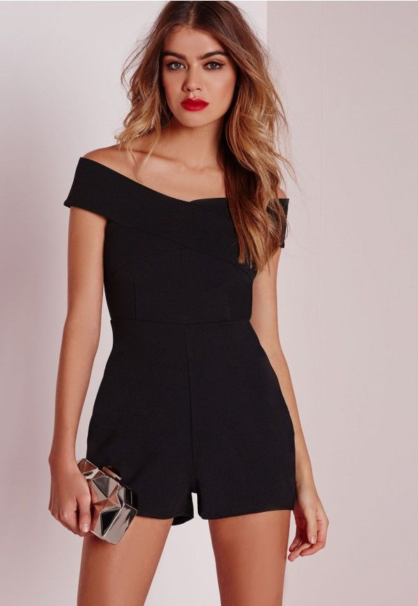 Ready to be playful?! Look kick ass in this seductive black playsuit which comes in a cute bardot style playsuit. With an invisible back zip fastening and cross over detailing to the front, wear with strappy heels and a cute clutch for mini...