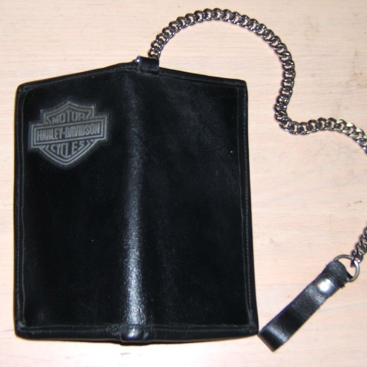 Harley Biker's Wallet, Full Grain Cowhide with card holders and two cash pockets, satin lined with your patch sewn onto it, or choose the vegetable tanned Full Grain Cowhide to have your favorite design tooled onto the shell. Flat chrome chain with your choice of length, chrome snapped leather loop on a d-ring fastener to keep it on your hip.