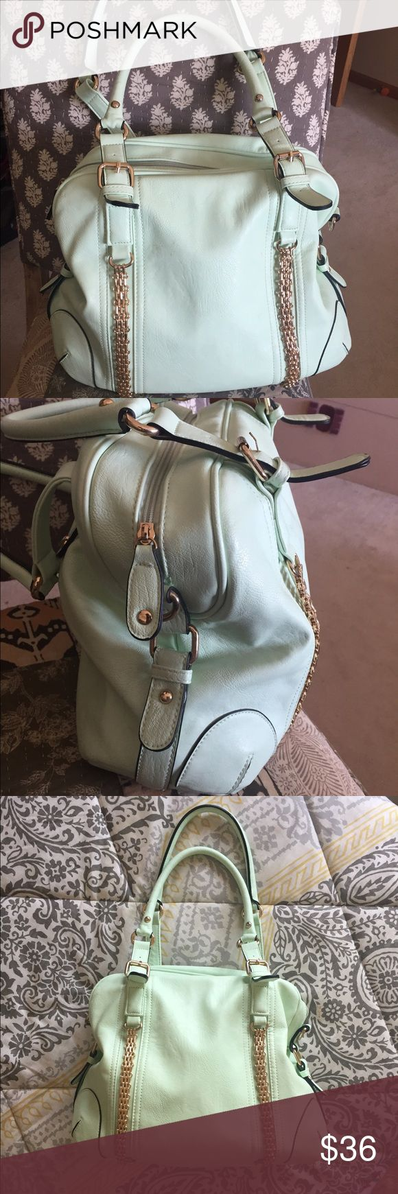 Wilson's leather mint green shoulder bag. Wilson's Leather mint green shoulder bag with pretty gold accents.  (Brand says Black River, but was purchased at Wilsons). Very pretty for spring and summer.  Very pretty floral interior as pictured.  Gold chains on front still great shape.  This is gently used and has a faint scuff on the front near the top as pictured, and a faint mark on the top by the zipper as pictured.  Measures 14x11x 5 1/2.  Not 100% ready to part.... Black Rivet Bags…