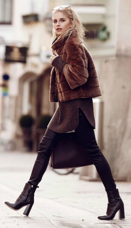 Caroline Daur is a vision in brown, rocking a pair of tight leather leggings, an oversized knit sweater, and a cute cropped faux fur jacket. Finish the look off with a pair of heeled ankle boots to recreate this look. Via Just The Design.   Jacket: Hallhuber, Pullover: Bogner, Shoes: Zara, Sunglasses: Jimmy Choo, Bag - Aigner.