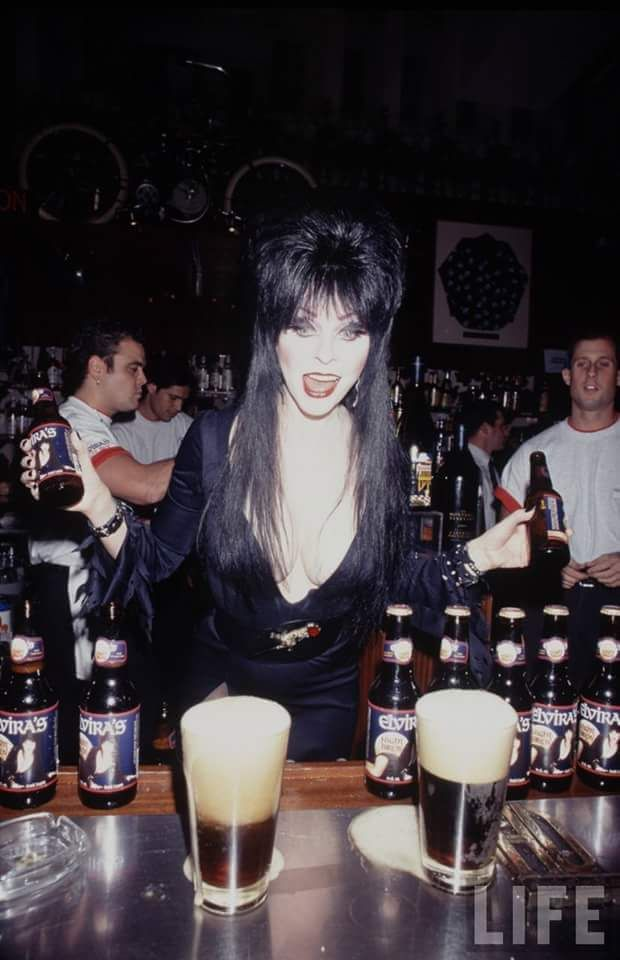 Elvira Mistress Of The Dark and her beer.