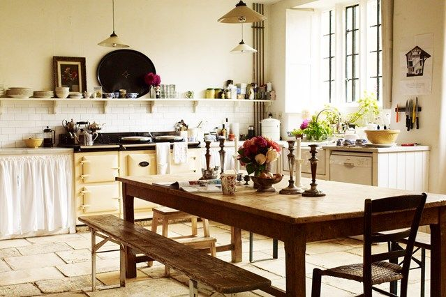 Country Kitchen with Cream Aga in Kitchen Design Ideas on HOUSE. Wooden benches and stone floor in the home of Bridget Elworthy, one half of garden design duo The Land Gardeners.