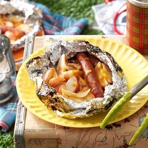 BBQ Hot Dog & Potato Packs Recipe -For these nifty foil packs, small hands make quick work of topping potato wedges with a hot dog, onions and cheese. — Kelly Westphal, Wind Lake, Wisconsin