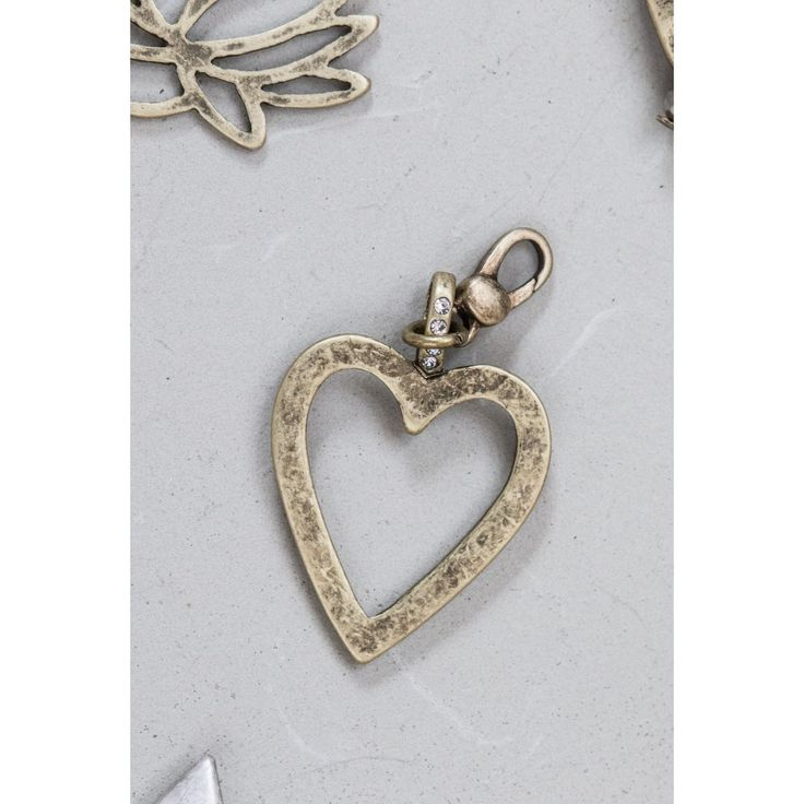 Accessorise your look this season with this gorgeous heart charm, featuring crystal details.  Ideal to be worn with plain chains, metal beaded bracelets and necklaces.  Available in Light Antique Gold.  Material:  Made from a mixture of metals - nickel free plating Size:  Height 4.2cm x Width 2.2cm