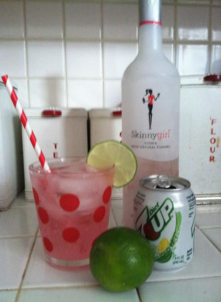 Diet Cherry Limeade Cocktail:  Skinny Girl White Cherry Vodka, Diet 7 Up, Lime, one drop of red food coloring or cherry juice.  (I used food coloring to keep calories a little lower)