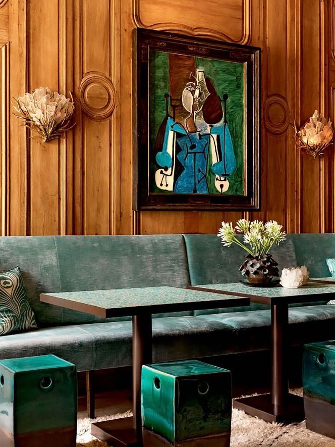 Wood panelling + beautifully faded velvet upholstery + Picasso.