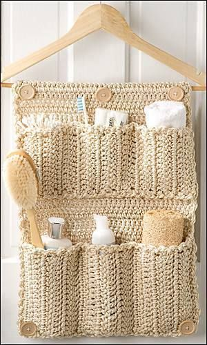 Crochet storage pouches on a wooden hanger..gorgeous.