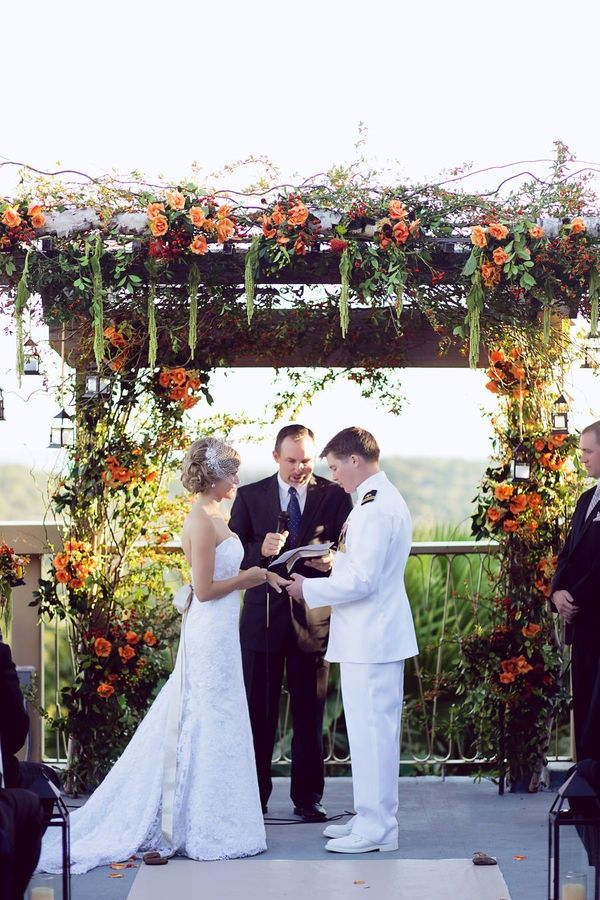orange coral roses wedding alter for rustic fall weddings# arbor# archway# autumn
