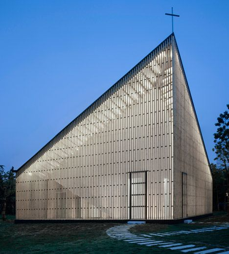 Garden chapel featuring semi-transparent walls and a butterfly roof. SIMPLE STRUCTURE BUT VERY AFFECTIVE