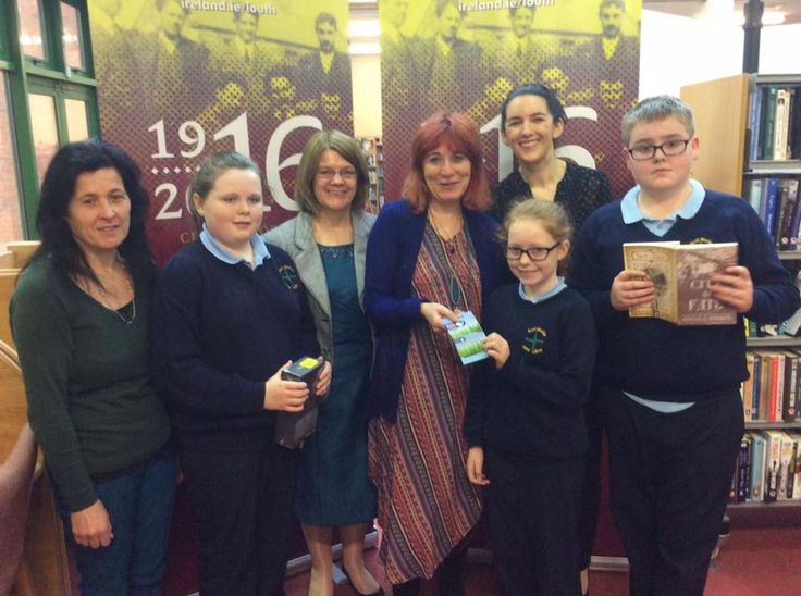 Nicola Pierce with school children from Dunleer, County Louth, presenting them with prizes for their short stories on 1916.