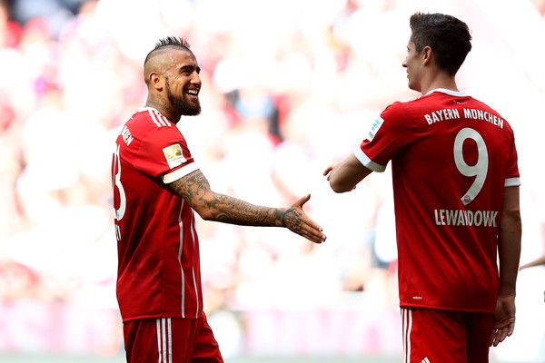 Robert Lewandowski Photos Photos - Arturo Vidal of Bayern Muenchen reacts with his team mate Robert Lewandowski during the Bundesliga match between Bayern Muenchen and SC Freiburg at Allianz Arena on May 20, 2017 in Munich, Germany. - Bayern Muenchen v SC Freiburg - Bundesliga