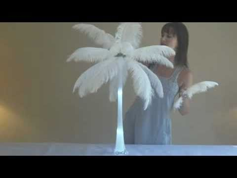 How to make feather centerpieces. We could replace the ostrich feathers with peacock feathers to match the theme.