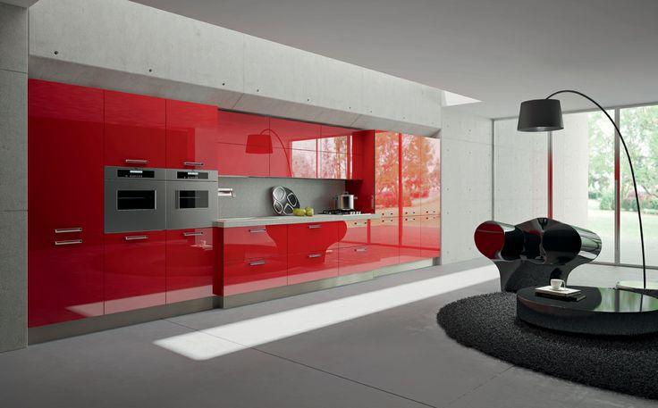Red acrylic doors. Gres Steel worktop. #ArritalCucine #Kculture #modern #kitchen #Light