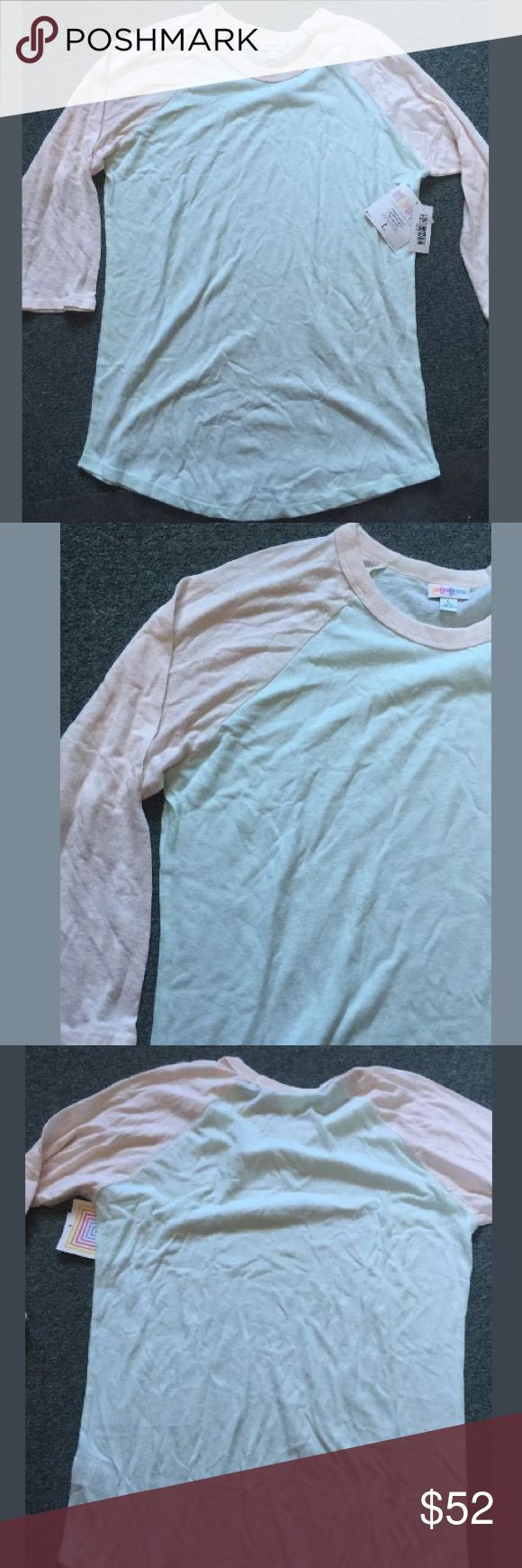 """Lularoe Randy shirt Pale Mint green W/pale pink L Lularoe Randy T-shirt New! Large Pale Mint green (almost teal blue) W/pale pink Sleeves  Women's size large measures 44"""" bust, 40"""" waist, 28"""" length shoulder to hemline  Brand new with tags!  Gorgeous soft pastel color item LuLaRoe Tops Tees - Long Sleeve"""