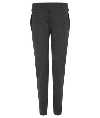 Star Pants - $189.95 - The Wellicious Star Pants feature rounded pockets with binding and a higher waistband you can wear up on cooler days or fold down for a differing waistband.  They have a tapered shape leg and they are suitable for exercise and of course well earned relaxing after exercise.  #fireandshine #yoga #fashion #ethical #activewear #loungewear #wellicious #black