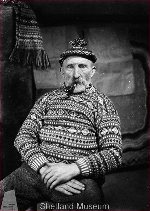 Johnnie Jamieson dressed in allover Fair Isle jumper and toorie.