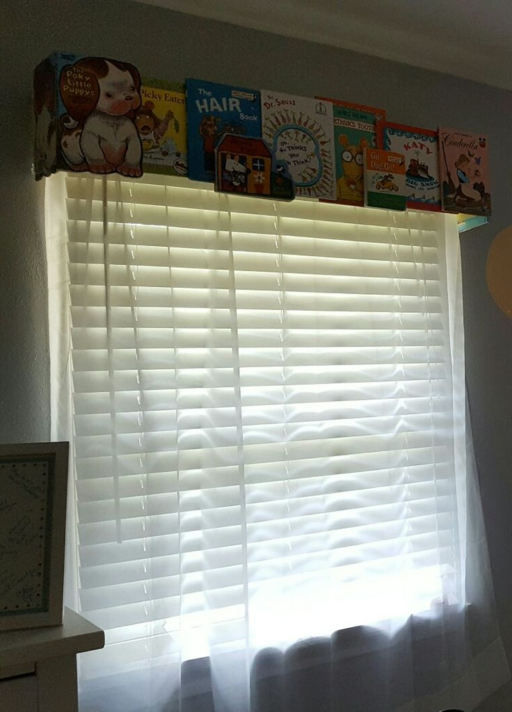 Baby nursery books window cornices infant room decor. My baby's room done by Leah Noel