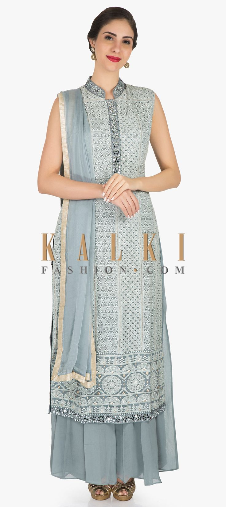 Buy Online from the link below. We ship worldwide (Free Shipping over US$100) Click Anywhere to TagGrey palazzo suit in georgette featuring the heavy thread and gotapatti work only on Kalki This grey palazzo suit showcases a style that is quite minimal yet striking. The suit is amazingly encrusted with heavy thread work embroidery with gotapatti border at the ends and at the collars. The suit is set together with a matching dupatta. Slight variation in color is possible.