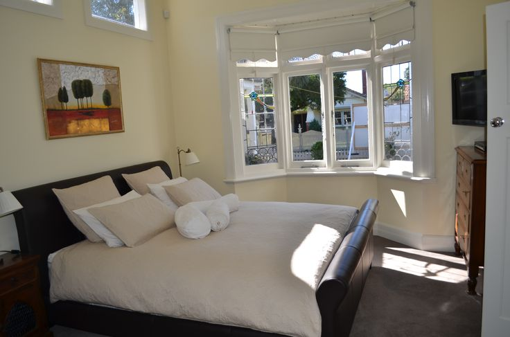 Traditional house.  Master bedroom. Bay window.  Neutral scheme. Lisa Banducci Design.