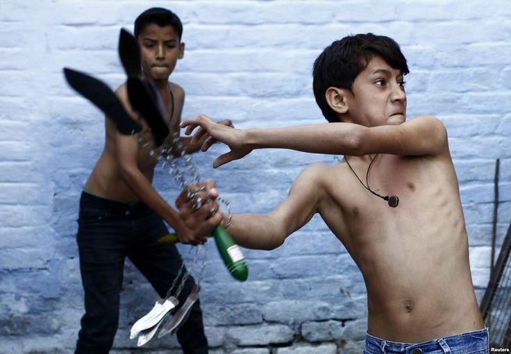 Shia boys begin to flagellate themselves during a Muharram procession ahead of Ashura in Amroha, India  http://earth66.com/human/shia-boys-begin-flagellate-muharram-procession-ahead-ashura-amroha-india/