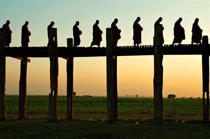 Monk silhouettes on bridge U Bein in Amarapura, Myanmar #travelingasia #burma