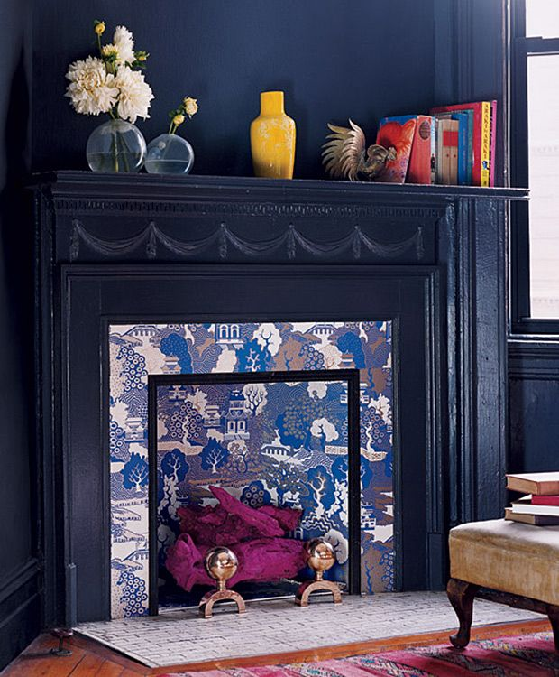 Styling a non-functioning fireplace can be a challenge. Try these 9 clever fixes, all found on Pinterest. | Photo: Annie Schlechter Design: Sebastian Sergeant, Stephen Antonson