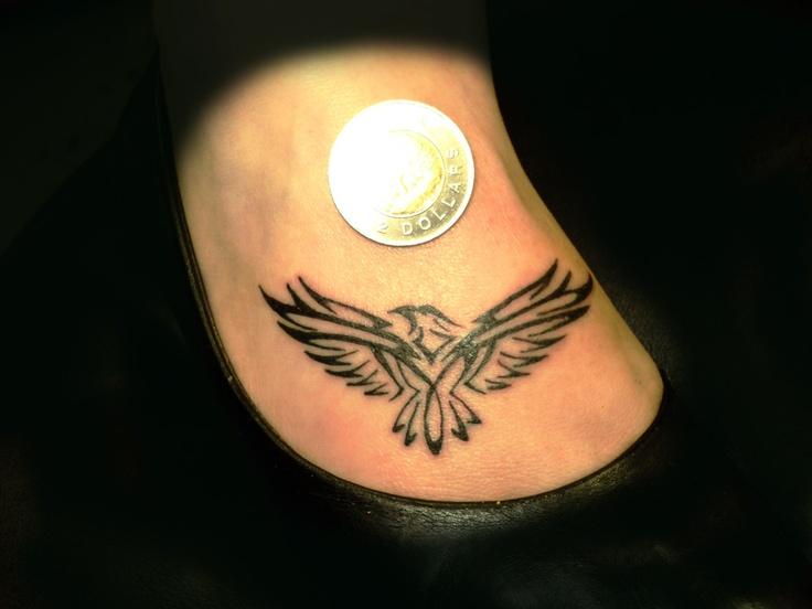 Small eagle incendiary tattoos on foot tattoos a for Small eagle tattoo