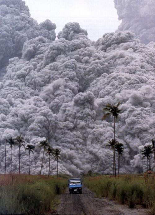 Mt. Pinatubo Eruption. Photo by Albert Garcia taken on June 15, 1991 // A volcano's deadly pyroclastic flow - the same thing that buried Pompeii. You can't outrun it: it travels at 700 km/h (450 mph) and you can't weather it in anything but highly specialized shelters: it's over 1,000 °C (1,830 °F). Once you see that in your rear view mirror, you're either already out of reach or you're not.