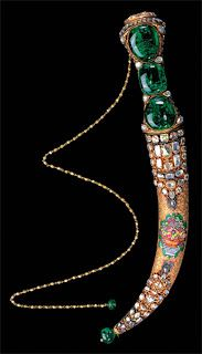 The jeweled dagger with its three cabochon emeralds, a tiny watch on its pommel and an enameled still life, according to Irepoglu, is the perfect embodiment of the eighteenth century refined taste as well as a reflection of the transition period of the Ottoman empire. This was commissioned by Sultan Mahmut I in 1747 as a diplomatic gift for Nadir Shah of Persia but when he was assassinated before the gifts could reach him, it was returned back to the Topkapi Palace.6