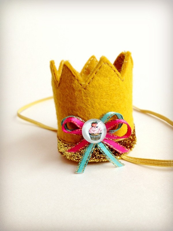Birthday Crown Gold Felt Mini Crown Headband Cupcake Bow. $16.00, via Etsy. I'm obsessed