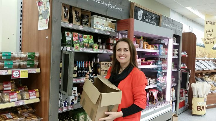 Putting Fused by Fiona Uyema flavoured soy sauce bottles on shelf in Supervalu stores.