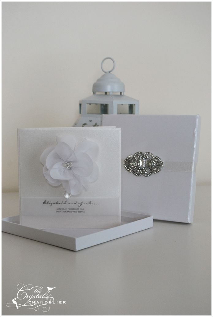 Wedding invitation at the crystal chandelier. LOVE